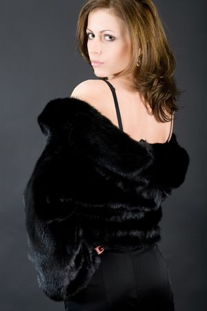 mink: The young beautiful girl in a black mink fur coat