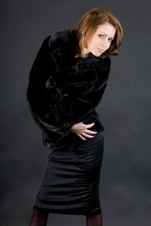 The young beautiful girl in a black mink fur coat Stock Photo - 6644441