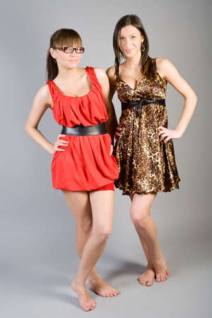 Two young beautiful girls in elegant dresses photo