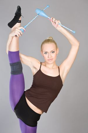 The young beautiful gymnast with sports maces photo