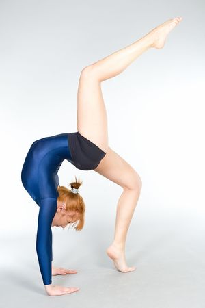 The young beautiful gymnast on training. photo