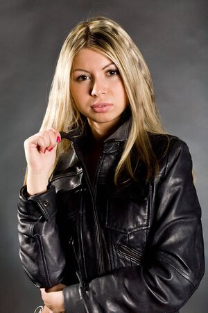 The young long-haired blonde in a leather jacket photo