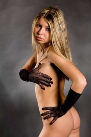 Portrait of the young bared girl in gloves Stock Photo - 7017314