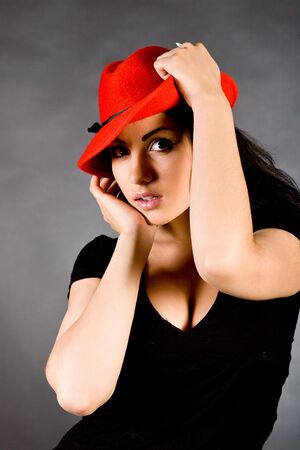 The young beautiful girl in a red hat Stock Photo