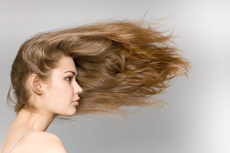 The beautiful long-haired girl on a grey background Stock Photo - 7455085