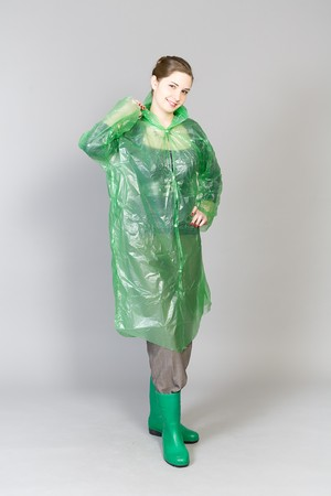 girl in a green raincoat and green boots