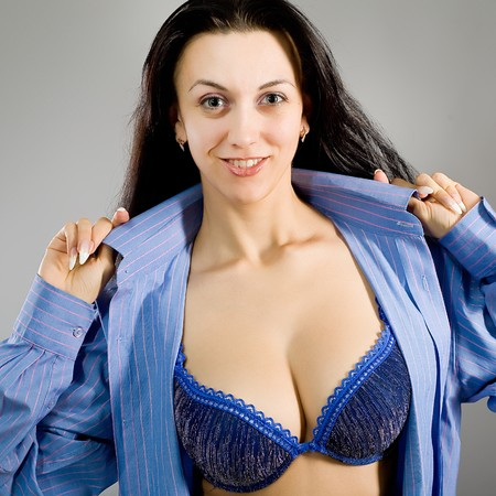 The young girl in dark blue linen with the big breast