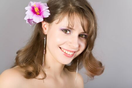 Portrait of the beautiful girl with a flower in hair Stock Photo - 10100496