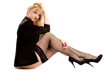 young woman in stockings and a black jacket. isolated on white Stock Photo - 12300658