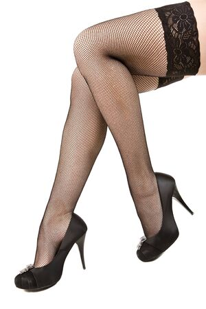 Female feet in black stockings and shoes on a high heel Stock Photo - 12300342