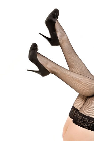 Female feet in black stockings and shoes on a high heel photo