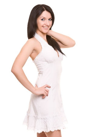 Portrait of the beautiful brunette in a light dress. Isolated on white. Stock Photo - 12300843