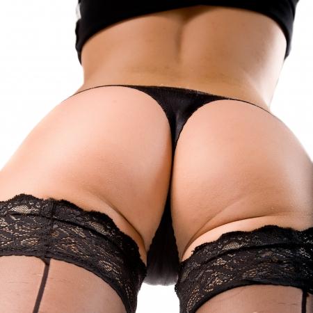 culo: ass di giovane donna. Isolato su bianco