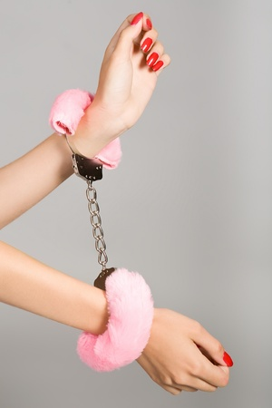 Female hands in handcuffs Stock Photo - 12300731