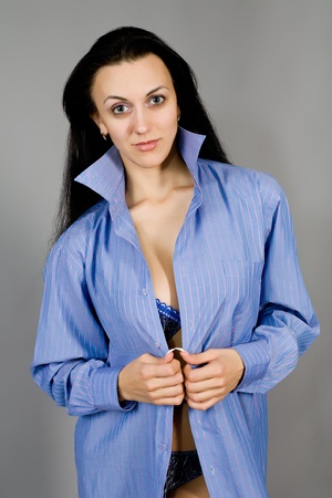 The young girl in dark blue linen with the big breast photo