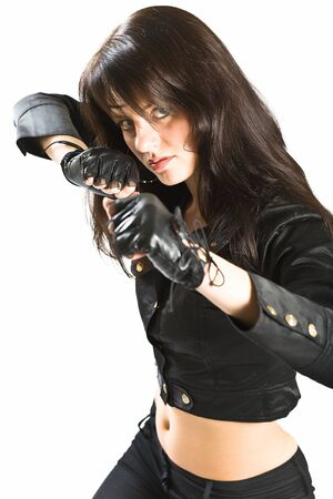 girl in a leather jacket and gloves on white photo