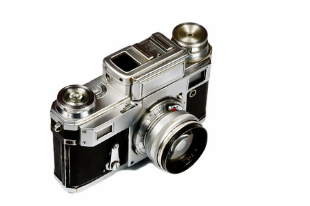Old film camera on a white background. Isolated photo