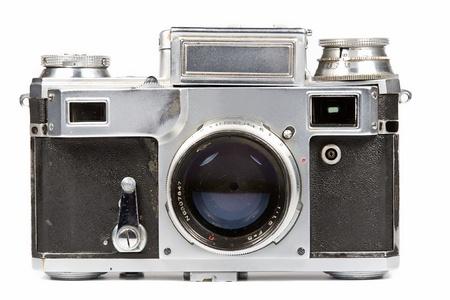 photo camera: Film di vecchia macchina fotografica su uno sfondo bianco. Isolato