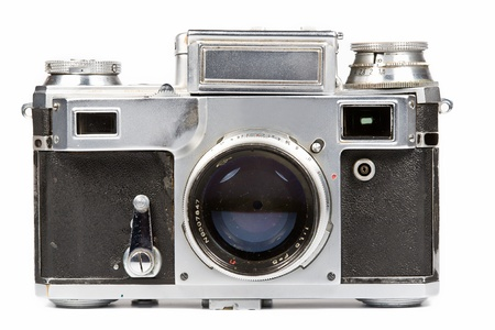 photo camera: Old film camera on a white background. Isolated