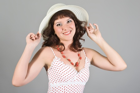 The young girl in a beautiful hat and an elegant dress photo