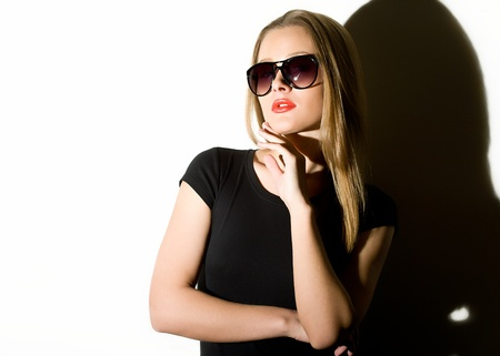 eye wear: beautiful girl to wearing spectacles and black clothes