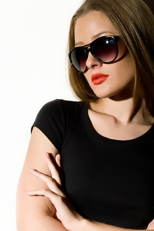 beautiful girl to wearing spectacles and black clothes photo