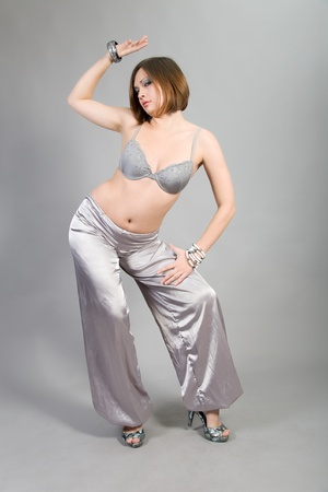 brunette in east suit of the dancer photo