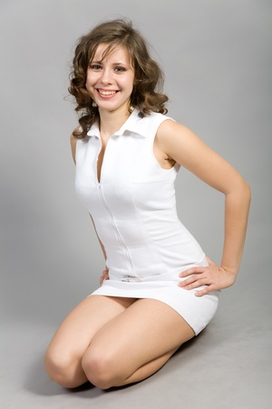 beautiful girl in a white short dress photo