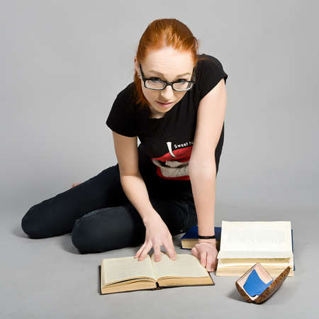 attractive red-haired girl with books photo
