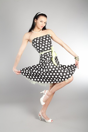 beautiful dancing girl in an elegant dress photo