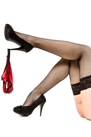 legs stockings: Attractive female feet and red woman pants. Isolated on white