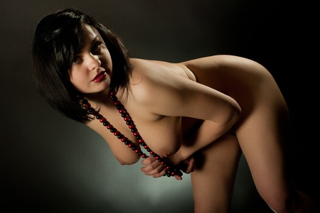 Portrait of the young nude woman with a necklace
