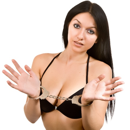 attractive woman in black linen and handcuffs