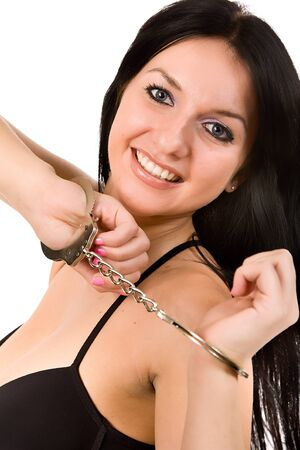 attractive woman in black linen and handcuffs photo