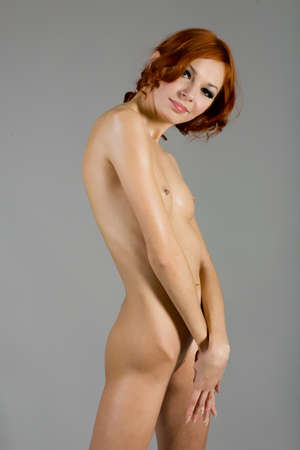 naked woman on a gray background Stock Photo - 12337478