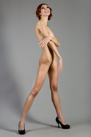 naked woman on a gray background Stock Photo - 12337456