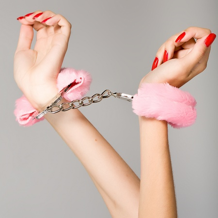 Female hands in handcuffs photo