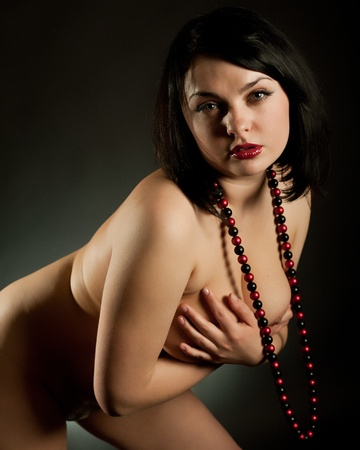 Portrait of the young nude woman with a necklace photo
