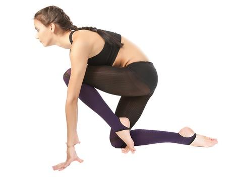 La joven gimnasta hermosa en la formación de El maestro de deportes Foto de archivo - 12549596