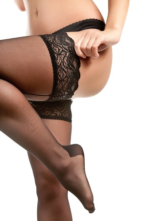 woman legs in stockings  Isolated on white