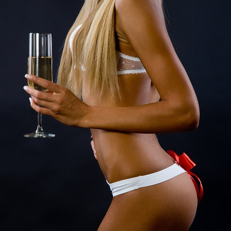 Wine glass in a hand of the girl on a black background Stock Photo - 12550330