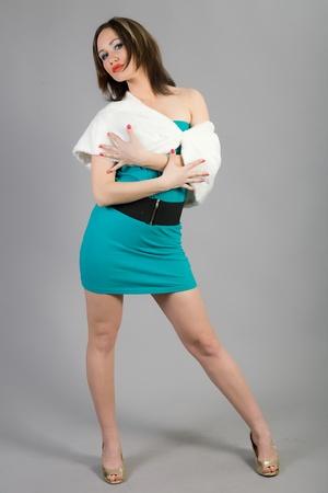 beautiful dancing girl in an elegant dress photo