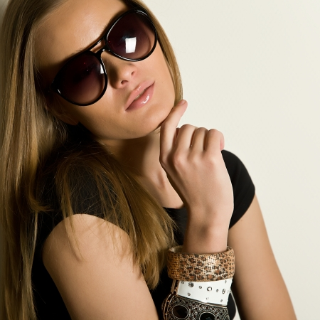 woman wearing glasses: young beautiful brunette wearing spectacles Stock Photo