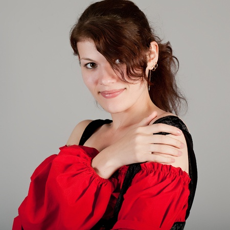 Portrait of the beautiful girl in a red dress photo