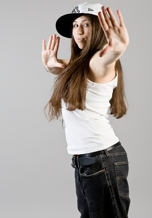young dancing girl in jeans photo