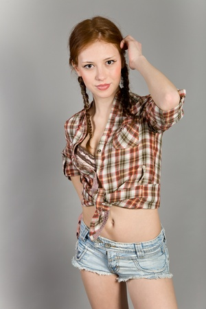 short shorts: young girl in a checkered shirt