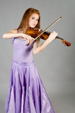 The young attractive girl with a violin photo
