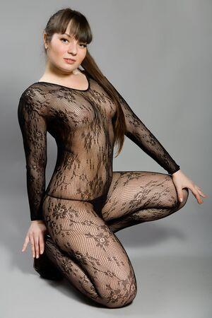 hot breast: Красивая брюнетка в эротическом костюме Фото со стока