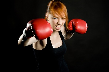 young attractive woman the boxer on training photo