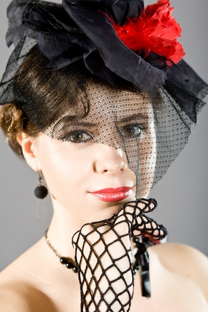 The effective girl in a beautiful hat photo